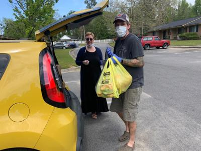 Lance couple delivers food