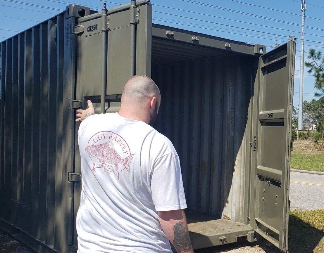 Volunteers provide storage container