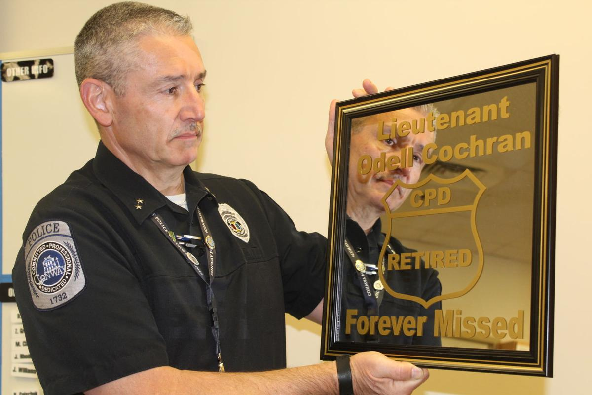 Chief Dale Long with plaque devoted to Odell Cochran