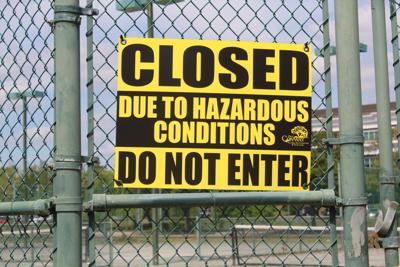 Tennis center closing sign