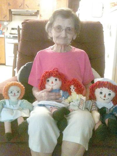 Gladys Cooper with Raggedy Ann and Andy dolls