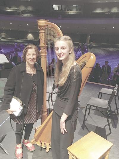Young harpist and teacher