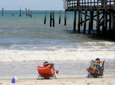 Beachgoers Relax Near What Remains Of The Springmaid Pier In Myrtle Beach Sunday Afternoon The Pier Which Is Part Of The Doubletree Resort By Hilton