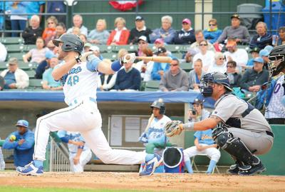 While Wearing A Myrtle Beach Pelicans Uniform Chicago Cubs Outfielder Chris Denorfia Left Swings At Pitch During Recent Against The Wilington