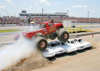 A monster truck flattens some cars during a 2008 monster truck rally at Myrtle Beach Speedway.