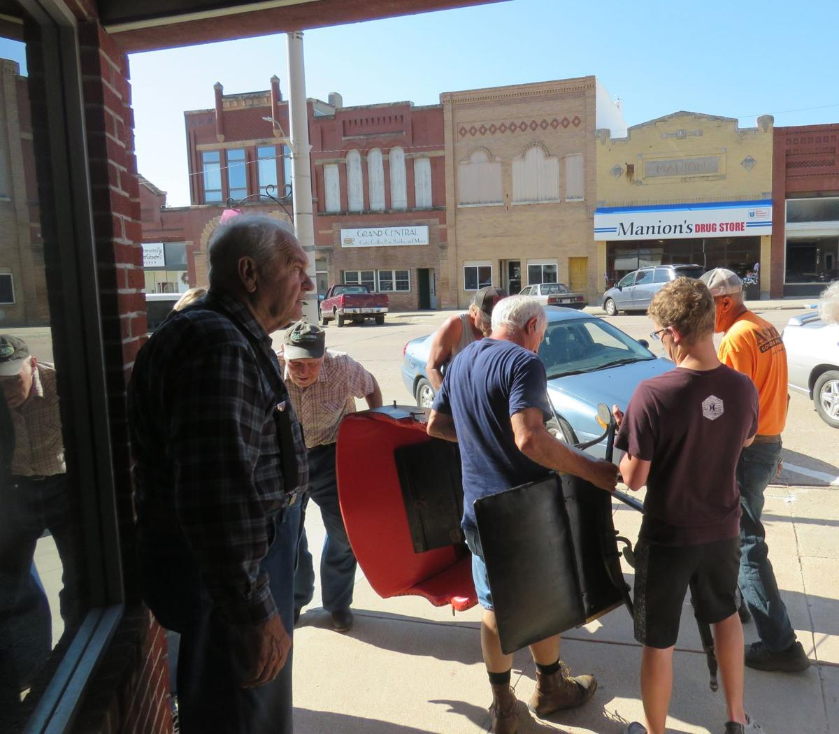 Volunteers bring the buggy into the historical center