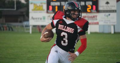 Brayden Zimmerer marches the ball down the field against Homer on Friday night.