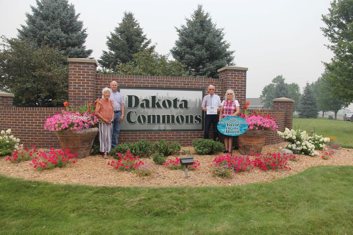 BUSINESS  - Dakota Commons Twinhome Owners Association on 19th St NE.  L to R - Linda Williams, Doug Harrington, Curt Kost (President), Jo Gardner.JPG