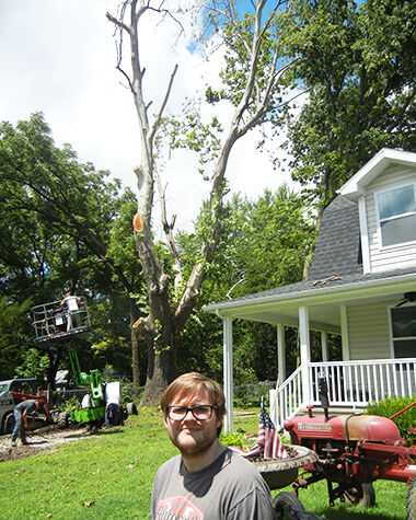 Mike Sievers of Festus with the approximately 100-year-old sycamore on his property that had died and needed to be cut down.
