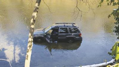 jeep stuck in big river