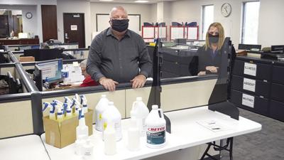 Jefferson County Clerk Ken Waller and Chief of Staff Jeannie Goff display a small assortment of protective equipment that will be in polling places for the June 2 election.