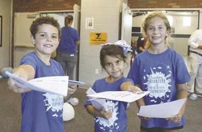 10 Christian Rains , Olivia Rivas and  greet guests at the open house.jpg