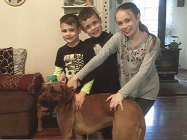 Theresa McKee's dog, Bruno Mars, with her grandkids Gavin, Mason and Ava Sagan in a March 2018 photo taken at her Barnhart home.