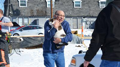 """Cutline: Dennis Sanchez recovered his cat, Lucy. She was unhurt, but frightened and hiding in the apartment. When asked if he had any comment, Sanchez stated that the """"local fire department is great!"""""""