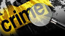 crime tape and magnifying glass.jpg