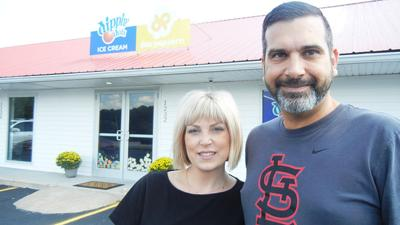 Marc and Andrea Yeida in front of the Dippin' Dots and popcorn shop they plan to open next week in Herculaneum.