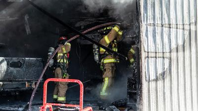 This garage on Old Sugar Creek Road was extensively damaged by fire Thursday morning.