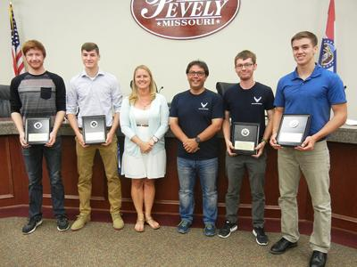 Pevely Mayor Stephanie Haas with high school grads who have enlisted in the military.
