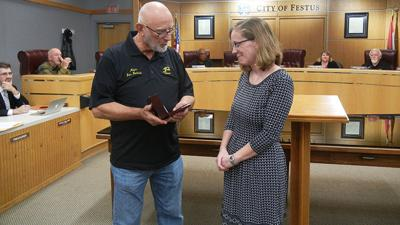 Festus Mayor Sam Richards honors outgoing library director Kathleen Condon-Boettcher.