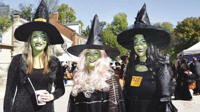 From left, Nicole Vien and Amanda Johnston, both of Arnold, and Linsey Betzer of Imperial enjoy last year's Kimmswick Witches Night Out.