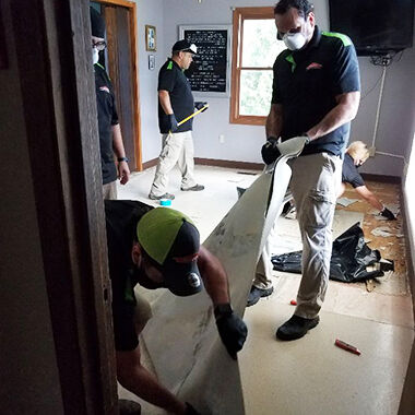 Crews work to clean up after flooding at the Jefferson County Rescue Mission in Pevely.