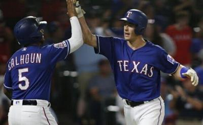 5 run 8th inning leads Texas past Seattle 7-4
