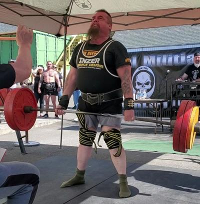 Malone's Mike Fournier sets new weightlifting record