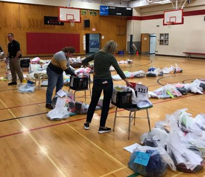 BMC employees organize student supplies