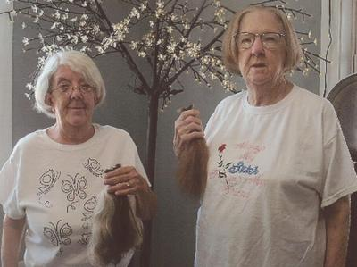 Local sisters donate to Locks of Love