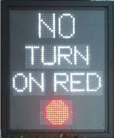 Pedestrian crossing vs. no turn on red signs