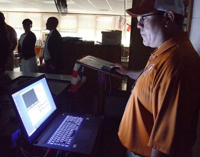 Jones High law enforcement instructors show use of force simulator, training