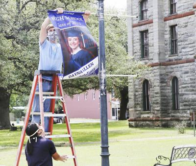 Grad photos on display along downtown streets