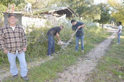 Notice in paper brings young volunteers to clear out old tree from disabled veteran's yard