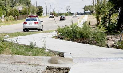 Sidewalk to college nears completion