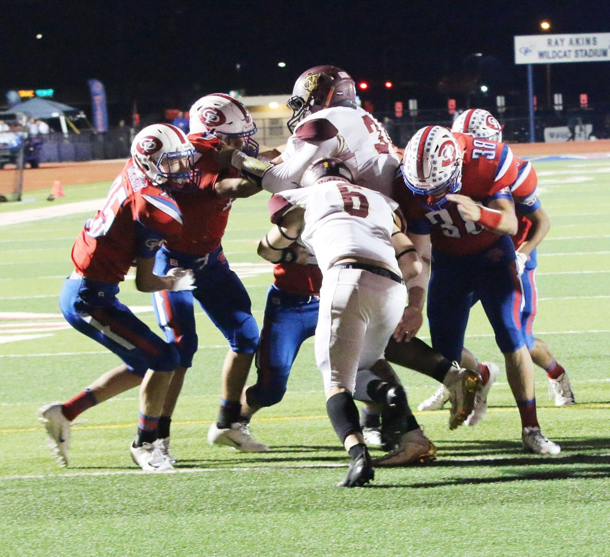 Wildcats fight off T-M, keep playoff hopes alive