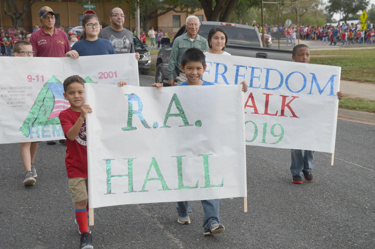 R.A. Hall students and faculty remember 9-11 attacks with Freedom Walk accompanied by first responders, veterans