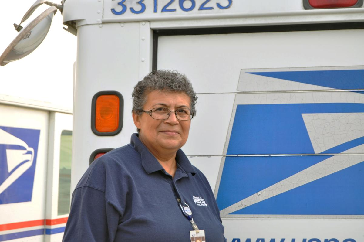 Mathis postal worker saves elderly woman's life