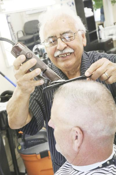 Barbershop reopens after near two months of closure