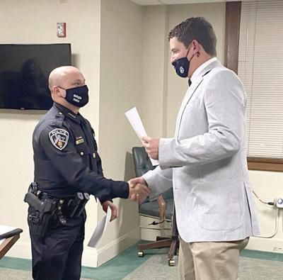 Back on his streets: Williams takes oath to police department