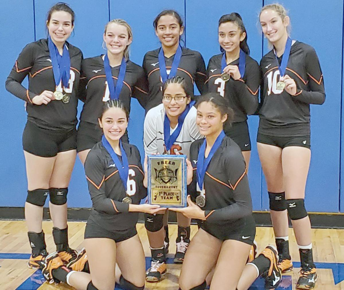Lady Cats take championship at Freer Tournament