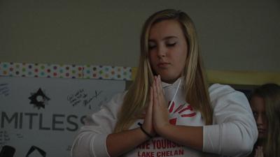 Health teacher gives students mental health lessons through yoga