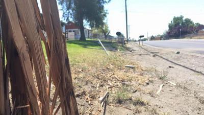 Three children injured in front yard when car crashes through fence