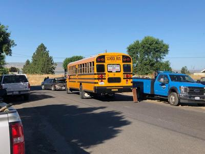 Washington State Patrol investigating crash between a car and school bus in Burbank