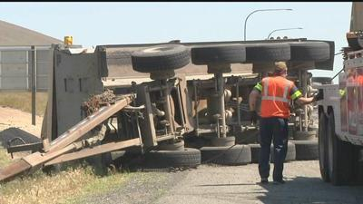 Truck trailer carrying asphalt tips and spills on I-82 westbound