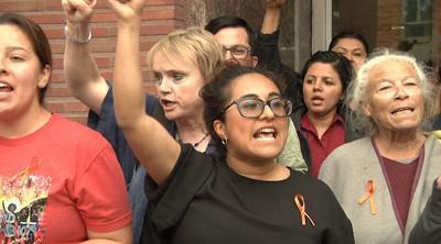 "People chanting ""Shut it down"""