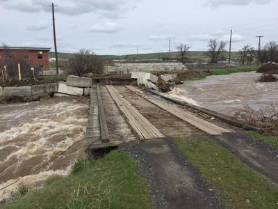 roads and bridges affected by flooding