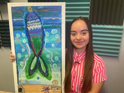 Woman with down syndrome expresses self through painting