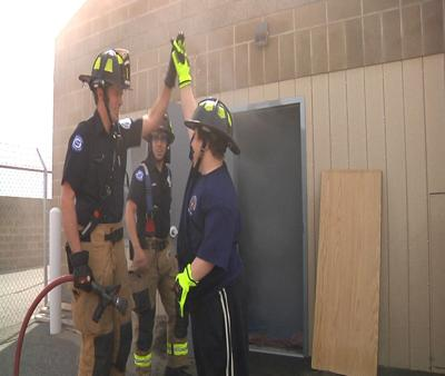 Pasco Firefighters give a boy from Arc of Tri-Cities the chance to be a firefighter for the day