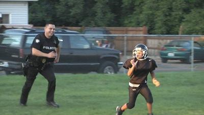 Football coaches use recent shooting to help kids appreciate law enforcement