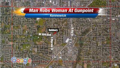 Woman in her car robbed at gunpoint